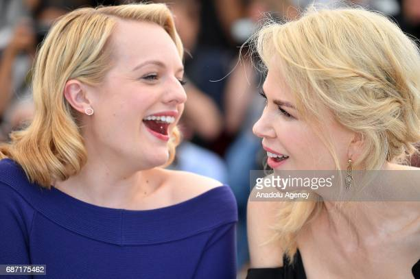 Australian actress Nicole Kidman and US actress Elisabeth Moss pose during a photocall for the film Top Of The Lake China Girl photocall out of...