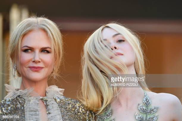Australian actress Nicole Kidman and US actress Elle Fanning arrive on May 21 2017 for the screening of the film 'How to talk to Girls at Parties' at...