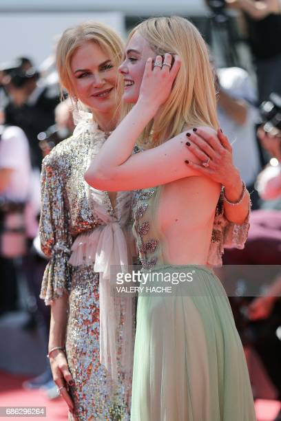 Australian actress Nicole Kidman and US actress Elle Fanning pose as they arrive on May 21 2017 for the screening of the film 'How to talk to Girls...