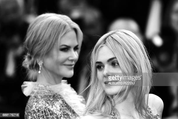 Australian actress Nicole Kidman and US actress Elle Fanning pose as they leave on May 21 2017 following the screening of the film 'How to talk to...