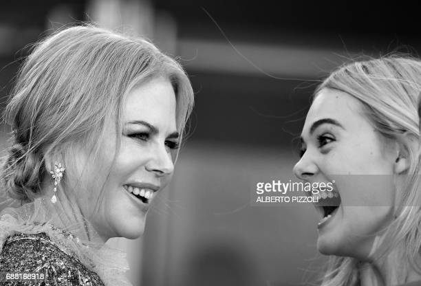 Australian actress Nicole Kidman and US actress Elle Fanning react as they arrive on May 21 2017 for the screening of the film 'How to talk to Girls...