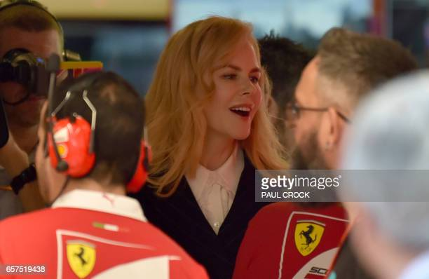 Australian actress Nicole Kidman meets with Ferarri team members during a visit to the gargage ahead of the Formula One Australian Grand Prix in...