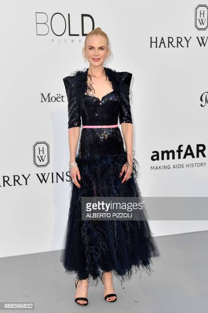 Australian actress Nicole Kidman poses as she arrives for the amfAR's 24th Cinema Against AIDS Gala on May 25 2017 at the Hotel du CapEdenRoc in Cap...