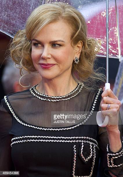 Australian actress Nicole Kidman poses for pictures on the red carpet upon arrival for the world premiere of 'Paddington' in London on November 23...