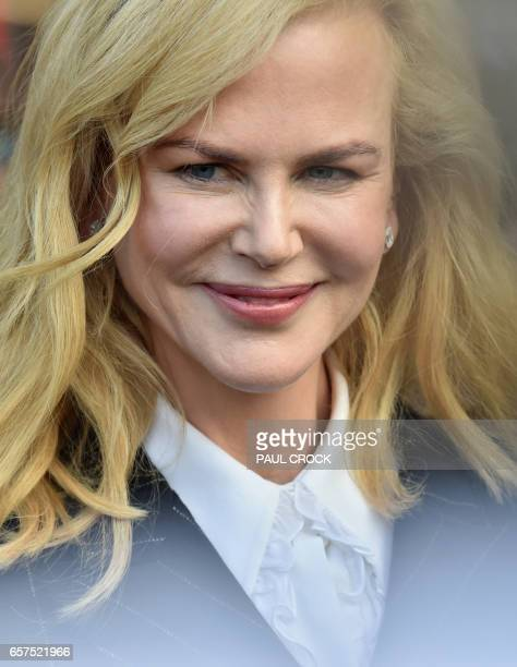Australian actress Nicole Kidman smiles to fans during a visit to the Ferrari gargage ahead of the Formula One Australian Grand Prix in Melbourne on...