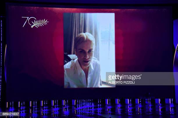 Australian actress Nicole Kidman speaks on a recorded video projected in the theater after she was awarded on May 28 2017 with the 70th edition...