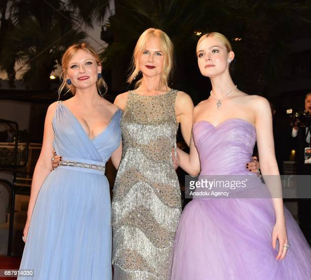Australian actress Nicole Kidman US actress Kirsten Dunst and US actress Elle Fanning leave after the premiere of the film The Beguiled in...