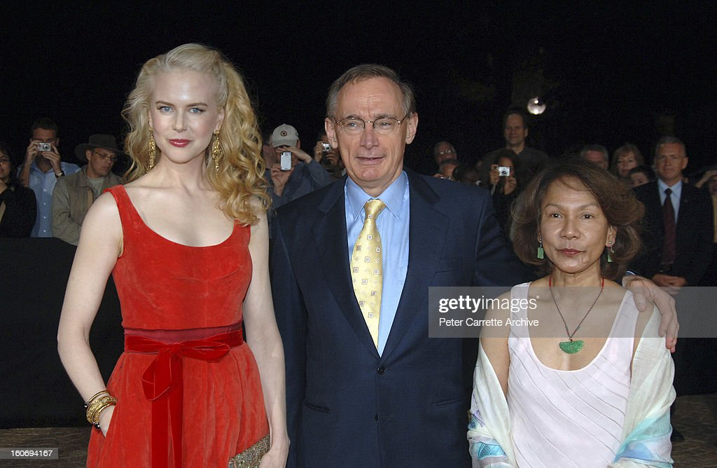 Australian actress <a gi-track='captionPersonalityLinkClicked' href=/galleries/search?phrase=Nicole+Kidman&family=editorial&specificpeople=156404 ng-click='$event.stopPropagation()'>Nicole Kidman</a> with NSW Premier <a gi-track='captionPersonalityLinkClicked' href=/galleries/search?phrase=Bob+Carr&family=editorial&specificpeople=209391 ng-click='$event.stopPropagation()'>Bob Carr</a> and his wife Helena Carr arrive for the World Premiere of the film 'The Interpreter' at the Sydney Opera House on April 04, 2005 in Sydney, Australia.