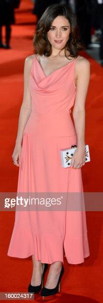 Australian actress Rose Byrne poses for pictures on the red carpet as she arrives to attend the European premier of 'I Give It A Year' in central...