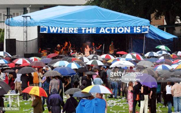 Australian actress turned pop singer Natalie Imbruglia as the rain pours down performs during the Blue Square Shergar Cup postrace party at Royal...