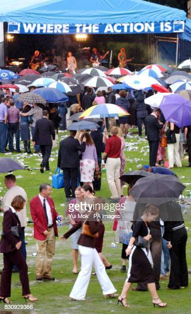 Australian actress turned pop singer Natalie Imbruglia performs as the rain pours down during the Blue Square Shergar Cup postrace party at Royal...