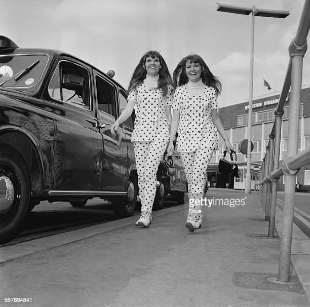 Australian actress twins Katherine and Karen Kessey arrive at London Airport 4th September 1967