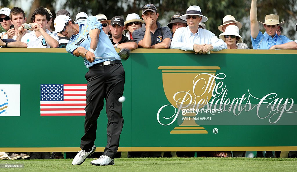Australian <a gi-track='captionPersonalityLinkClicked' href=/galleries/search?phrase=Adam+Scott+-+Golfer&family=editorial&specificpeople=202039 ng-click='$event.stopPropagation()'>Adam Scott</a> tees off as he and South Korea's K.J. Choi defeat <a gi-track='captionPersonalityLinkClicked' href=/galleries/search?phrase=Tiger+Woods&family=editorial&specificpeople=157537 ng-click='$event.stopPropagation()'>Tiger Woods</a> and K.J. Choi of the US during their President's Cup tournament match played at the Royal Melbourne golf course, in Melbourne on November 17, 2011. A non-European International team, comprising golfers from Australia, South Africa, Japan and South Korea, takes on the US for the President's Cup trophy. AFP PHOTO / WILLIAM WEST