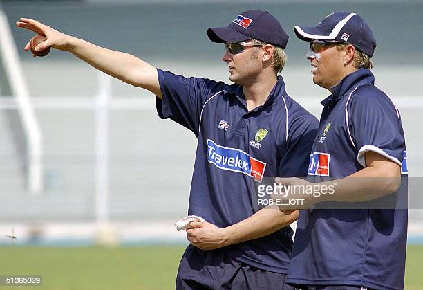 Australian all rounder Michael Clarke gestures as he chats with wizard bowler Shane Warne at a nets session in Bombay 28 September 2004 Australia...