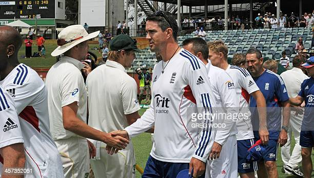 Australian and England team members shake hands following Australia's Ashes cricket win over England on the fifth day of the third Ashes cricket Test...