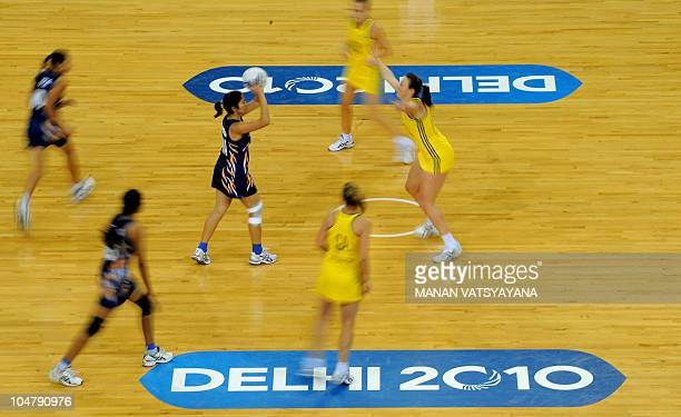 Australian and Indian netball players compete during a women's group match in the XIX Commonwealth Games at the Thyagaraj Stadium in New Delhi on...