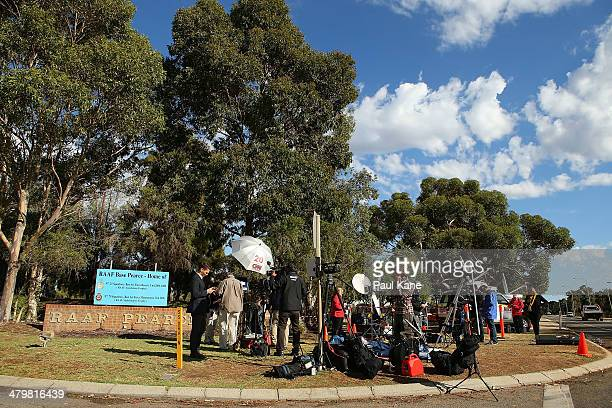 Australian and international media perform live news crosses from outside the Royal Australian Air Force base Pearce on March 21 2014 in Perth...