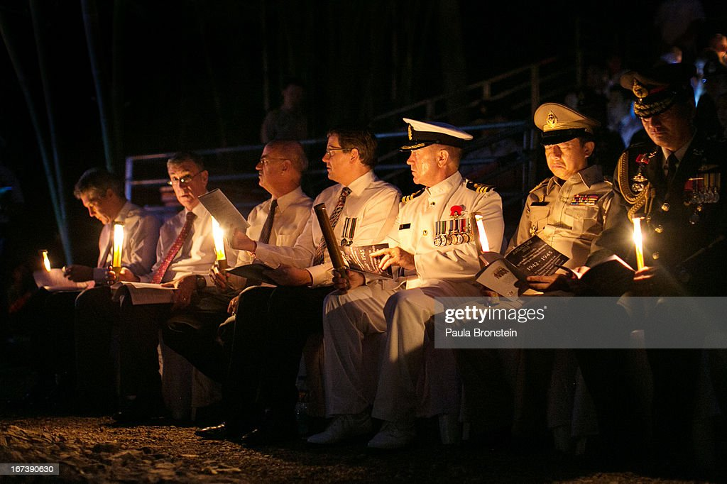 Australian and New Zealand dignitaries (L to R) Mr. Stephen Smith MP, Australian Minister for Defense, Australian Senator John Hogg, James Wise, Australian Ambassador to Thailand, and Tony Lynch, New Zealand Ambassador to Thailand sit along side others attending the sunrise memorial service in remembrance of all those who lost their lives April 25, 2013 in Hellfire Pass, Thailand. Hellfire Pass is a small section of the Burma-Thailand railway which was built by POW's and Asian Laborers under horrific conditions during the Second World War (WWII). Heavy loss of life was suffered during construction due to disease, starvation and exhaustion.