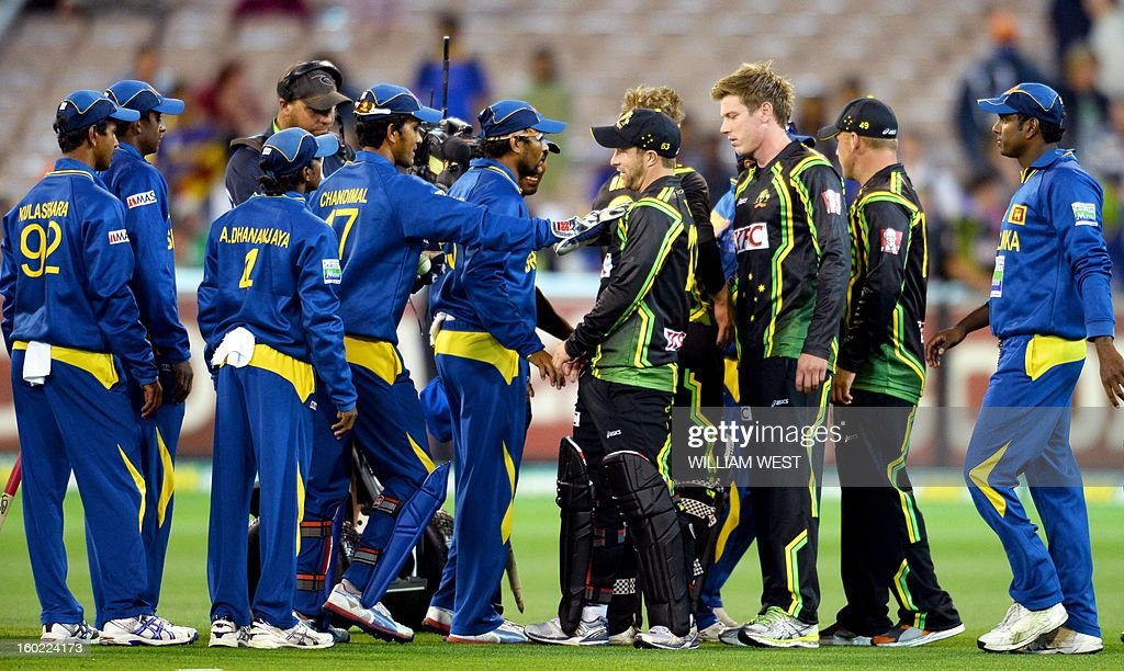 Australian and Sri Lankan players confront each other after the final ball in their Twenty20 match played at the Melbourne Cricket Ground (MCG), on January 28, 2013. AFP PHOTO/William WEST IMAGE