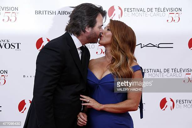 Australian and US actress Poppy Montgomery and her husband Shawn Sanford kiss during the opening ceremony of the 55th MonteCarlo Television Festival...