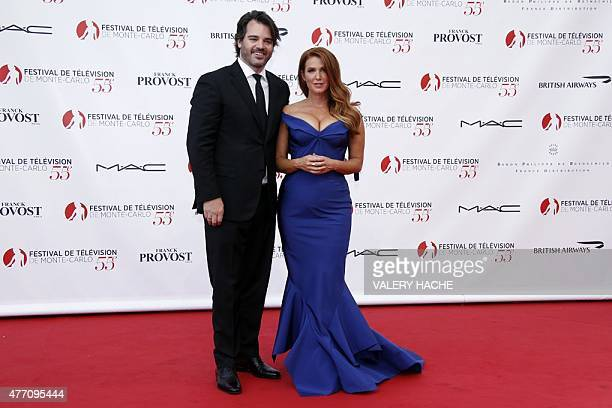 Australian and US actress Poppy Montgomery and her husband Shawn Sanford pose during the opening ceremony of the 55th MonteCarlo Television Festival...