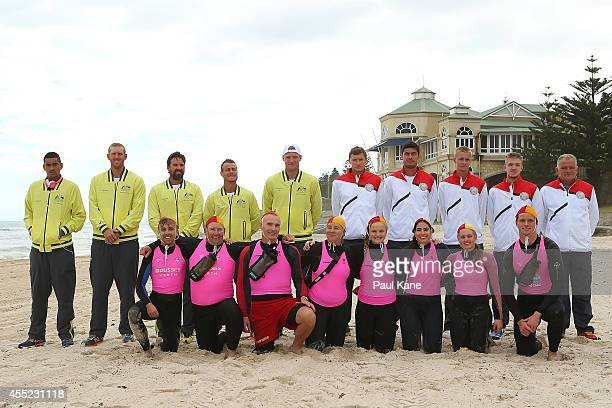Australian and Uzbekistan players pose for team photos with surf lifesavers after the Official Draw for the Davis Cup World Group Playoff between...