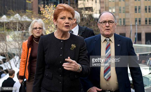 Australian antiimmigration firebrand Pauline Hanson walks away after speaking to the media in Sydney on June 3 2013 The controversial former One...