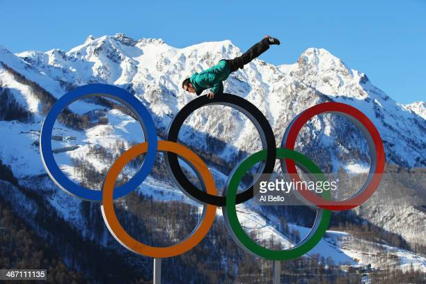 Australian arial skiier Dave Morris poses on the Olympic Rings in the Athletes Village ahead of the Sochi 2014 Winter Olympics at Rosa Khutor on...