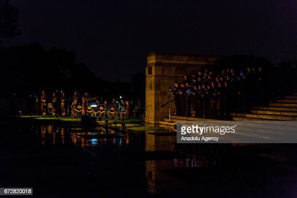 Australian Army orchestra and Melbourne Symphony Choir perform during the dawn service of the ANZAC day commemoration at the Shrine of Remembrance in...