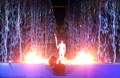 Australian athlete Cathy Freeman stands over the Olympic Flame after lighting it at the conclusion of the opening ceremony of the Sydney 2000 Olympic...