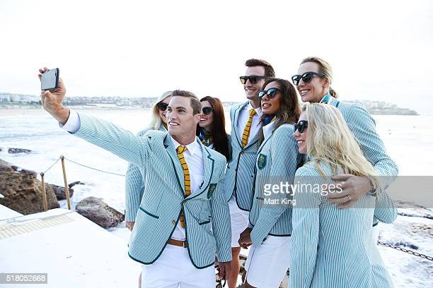 Australian athlete Ed Jenkins takes a selfie with other athletes during the Australian Olympic Games Opening Ceremony Uniform Official Launch at...