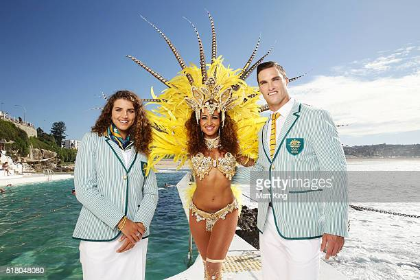 Australian athletes Jessica Fox and Ed Jenkins pose with a Brazilian dancer in the Australian 2016 Rio Olympic Games Opening Ceremony uniform during...