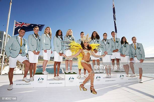 Australian athletes pose in the Australian 2016 Rio Olympic Games Opening Ceremony uniform with a Brazilian dancer during the Australian Olympic...