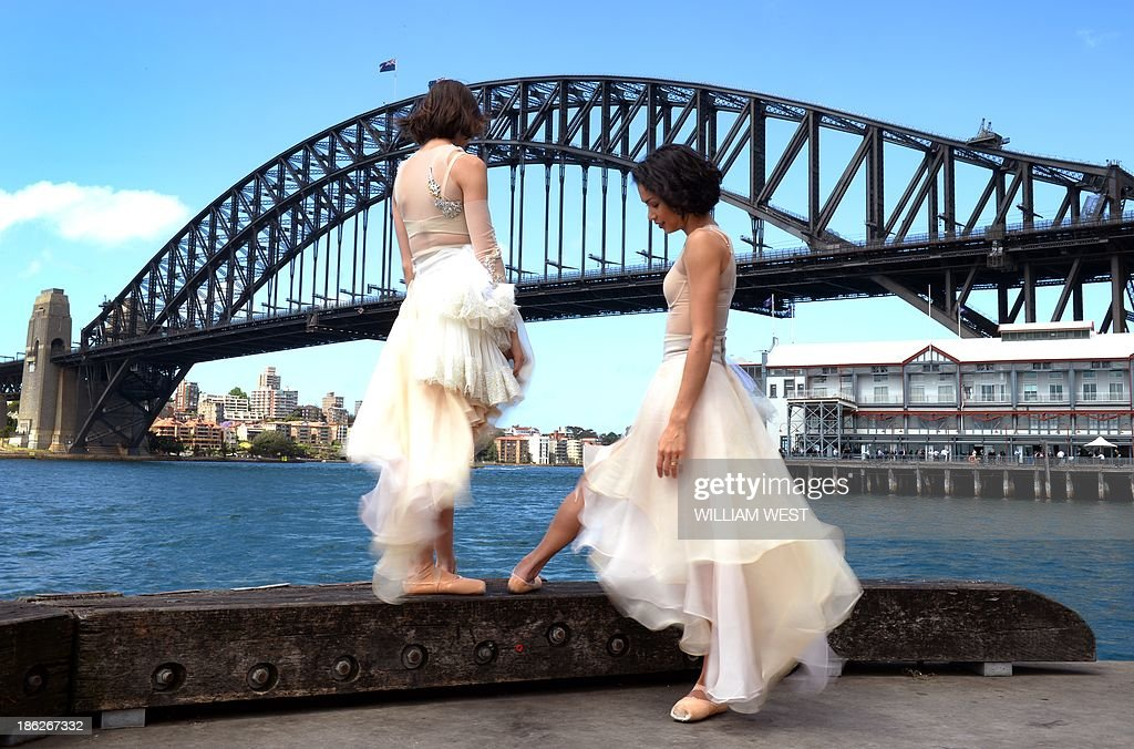 Australian ballet dancers Dimity Azoury (L) and Vivienne Wong (R) take a break at the unveiling of the Toni Maticevski designed costumes for the Australian Ballet production of Tinted Windows, part of the Bodytorque.Technique season opening this week in Sydney on October 30, 2013. The Australian Ballet has six brand-new works from up-and-coming Australian choreographers making their debut, creating a fantastic fusion of experimental ballet, design, fashion and music. AFP PHOTO/William WEST