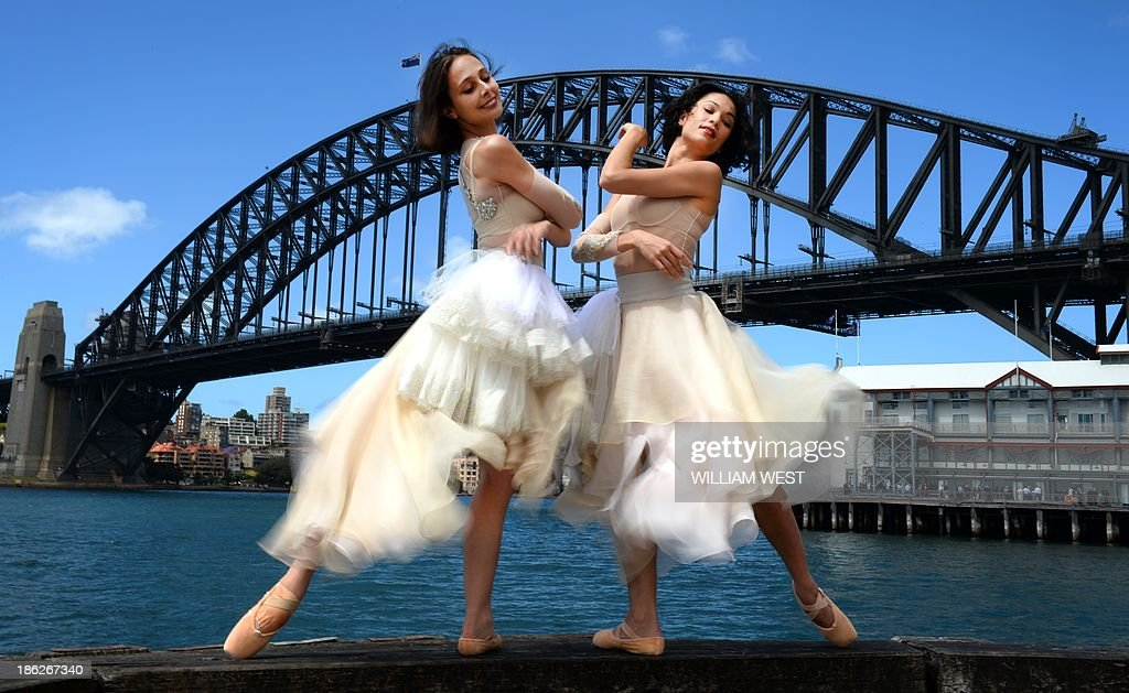 Australian ballet dancers Vivienne Wong (R) and Dimity Azoury (L) perform at the unveiling of the Toni Maticevski designed costumes for the Australian Ballet production of Tinted Windows, part of the Bodytorque.Technique season opening this week in Sydney on October 30, 2013. The Australian Ballet has six brand-new works from up-and-coming Australian choreographers making their debut, creating a fantastic fusion of experimental ballet, design, fashion and music. AFP PHOTO/William WEST