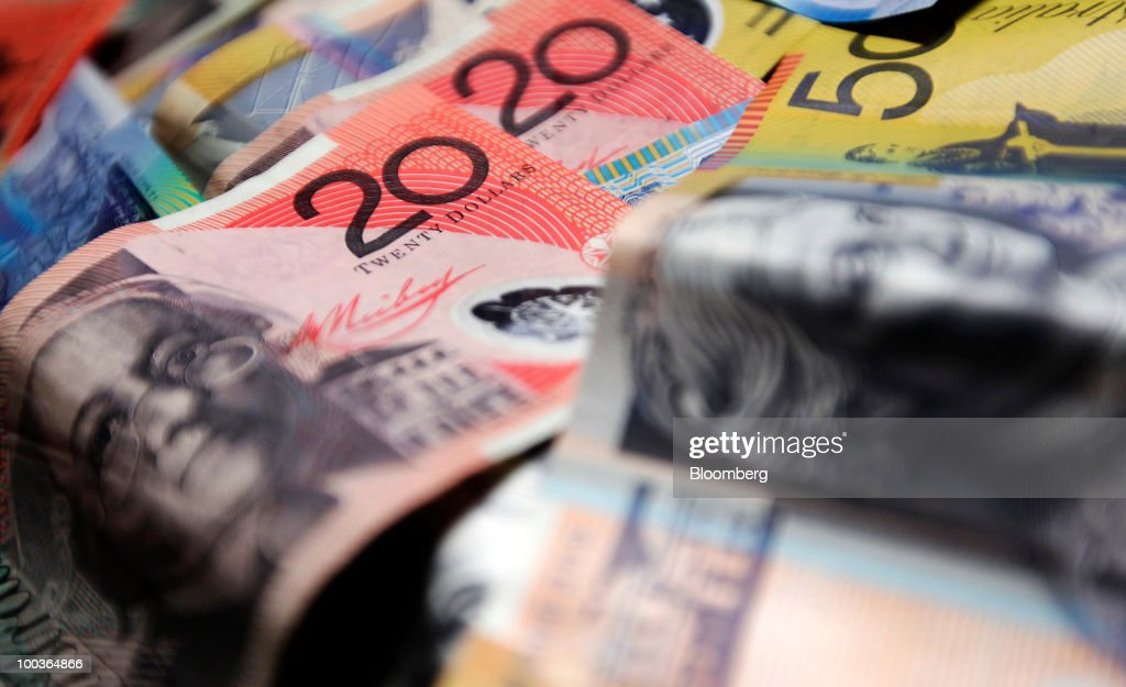 Australian banknotes in various denominations are arranged for a photograph in Sydney, Australia, on Monday, May 24, 2010. The Australian and New Zealand currencies slid for the sixth time in seven days against the U.S. dollar on concern Europe's debt crisis will spread. Photographer: Ian Waldie/Bloomberg via Getty Images
