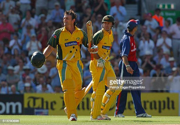 Australian batsman Adam Gilchrist celebrates reaching 100 runs with Ricky Ponting during the NatWest Challenge One Day International between England...