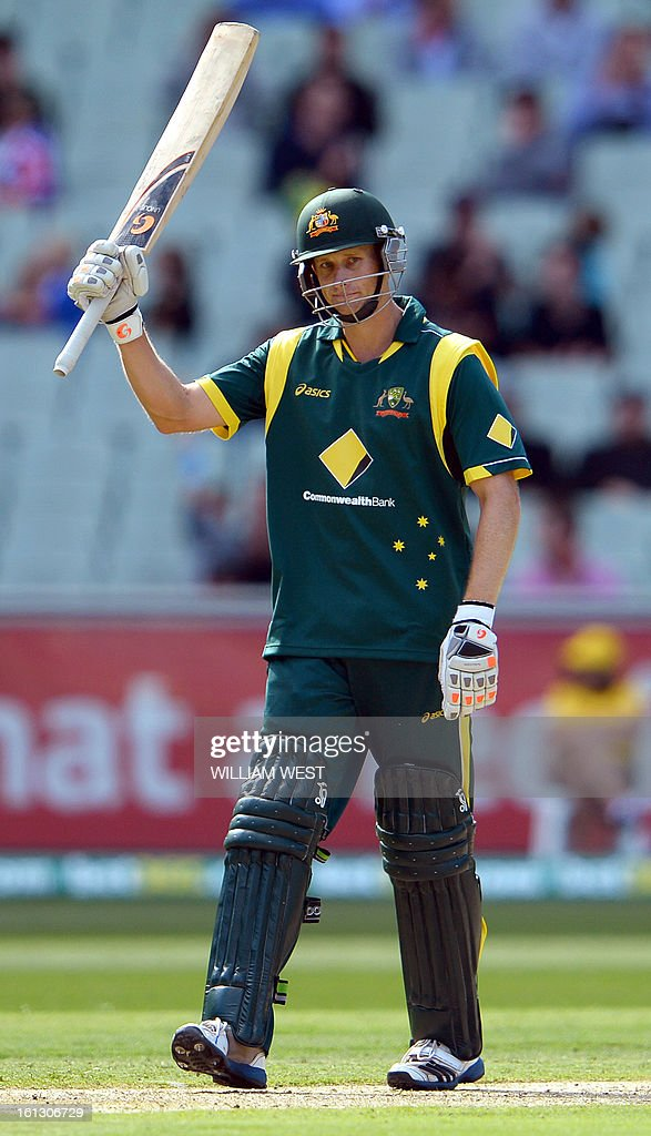 Australian batsman Adam Voges acknowledges the applause after scoring his 50 against the West Indies in their one-day cricket international played at the Melbourne Cricket Ground (MCG), on February 10, 2013. AFP PHOTO/William WEST IMAGE