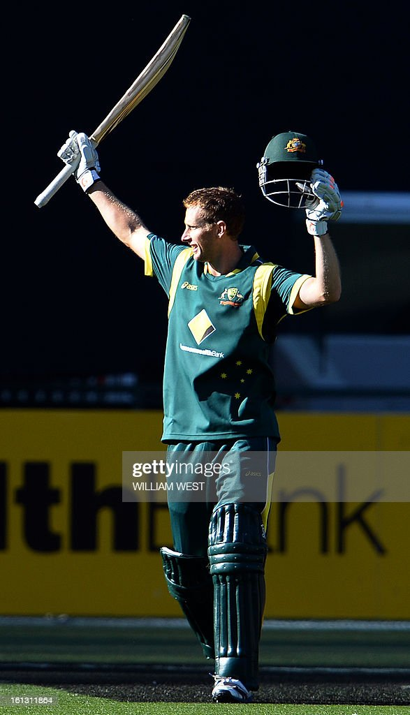 Australian batsman Adam Voges celebrates scoring his century against the West Indies in their one-day cricket international played at the Melbourne Cricket Ground (MCG), on February 10, 2013. AFP PHOTO/William WEST IMAGE