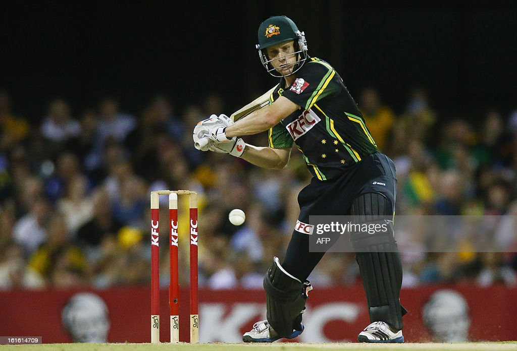 Australian batsman Adam Voges hits a shot against the West Indies during their international T20 cricket match at the Gabba cricket ground in Brisbane on February 13, 2013. AFP PHOTO / Patrick HAMILTON