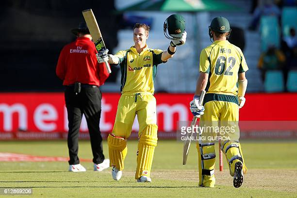Australian batsman and Captain Steven Smith celebrates scoring a century during the third ODI between South Africa and Australia at Kingsmead cricket...