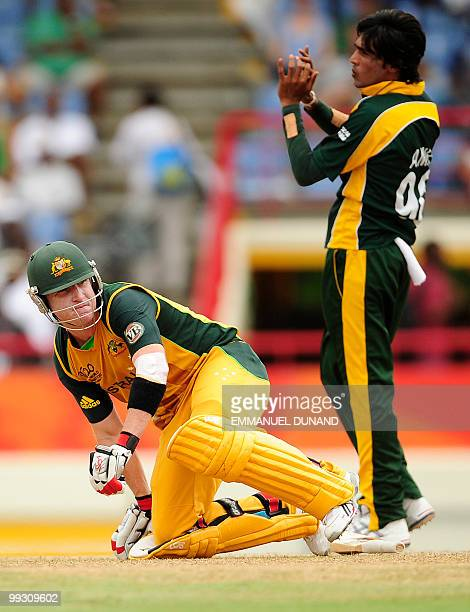Australian batsman Brad Haddin goes on his knees as Pakistani bowler Mohammad Aamer reacts during the ICC World Twenty20 second semifinal match...