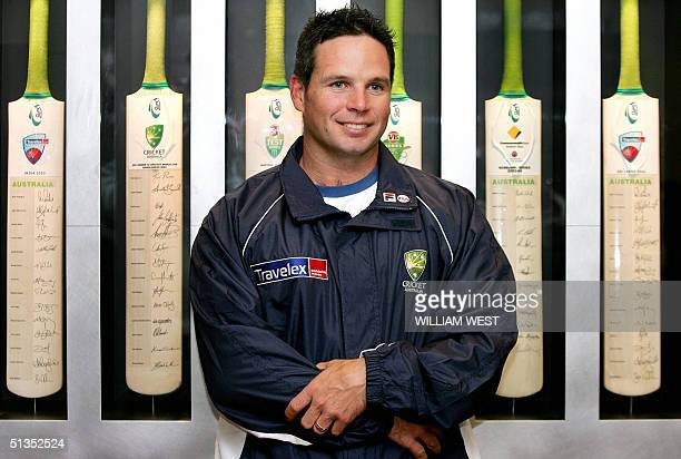 Australian batsman Brad Hodge smiles as he answers questions at the Australian Cricket Board offices before departing to join the Australian team for...