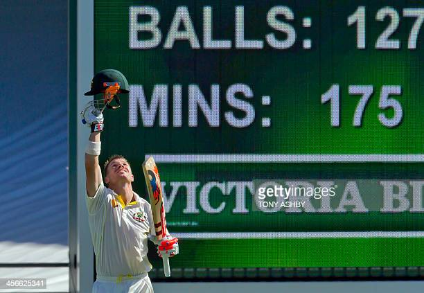 Australian batsman David Warner celebrates after scoring a century against England on the third day of the third Ashes cricket Test match in Perth on...