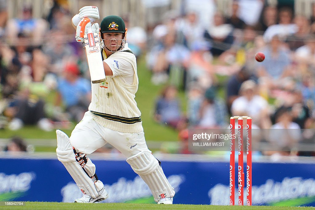 Australian batsman David Warner cuts a ball against Sri Lanka on the first day of the first cricket Test match in Hobart on December 14, 2012. AFP PHOTO/William WEST IMAGE RESTRICTED TO EDITORIAL USE - STRICTLY NO COMMERCIAL USE
