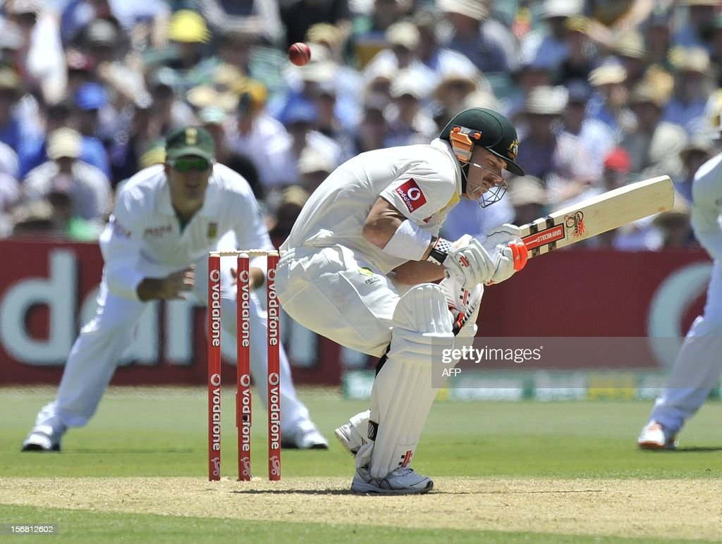 Australian Batsman David Warner ducks a high ball batting against South Africa on the first day of the second cricket Test match at the Adelaide Oval on November 22, 2012. AFP PHOTO/David Mariuz IMAGE STRICTLY FOR EDITORIAL USE - STRICTLY NO COMMERCIAL USE