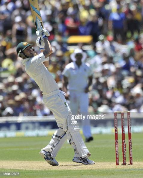 Australian batsman David Warner hits the ball against South Africa on the first day of the second cricket Test match at the Adelaide Oval on November...