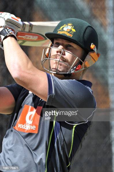 Australian batsman David Warner hits the ball in the nets ahead of the second cricket Test match against South Africa at the Adelaide Oval on...
