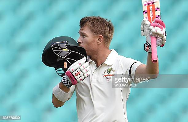 Australian batsman David Warner kisses his helmet after scoring his century against the West Indies on the final day of the third cricket Test match...