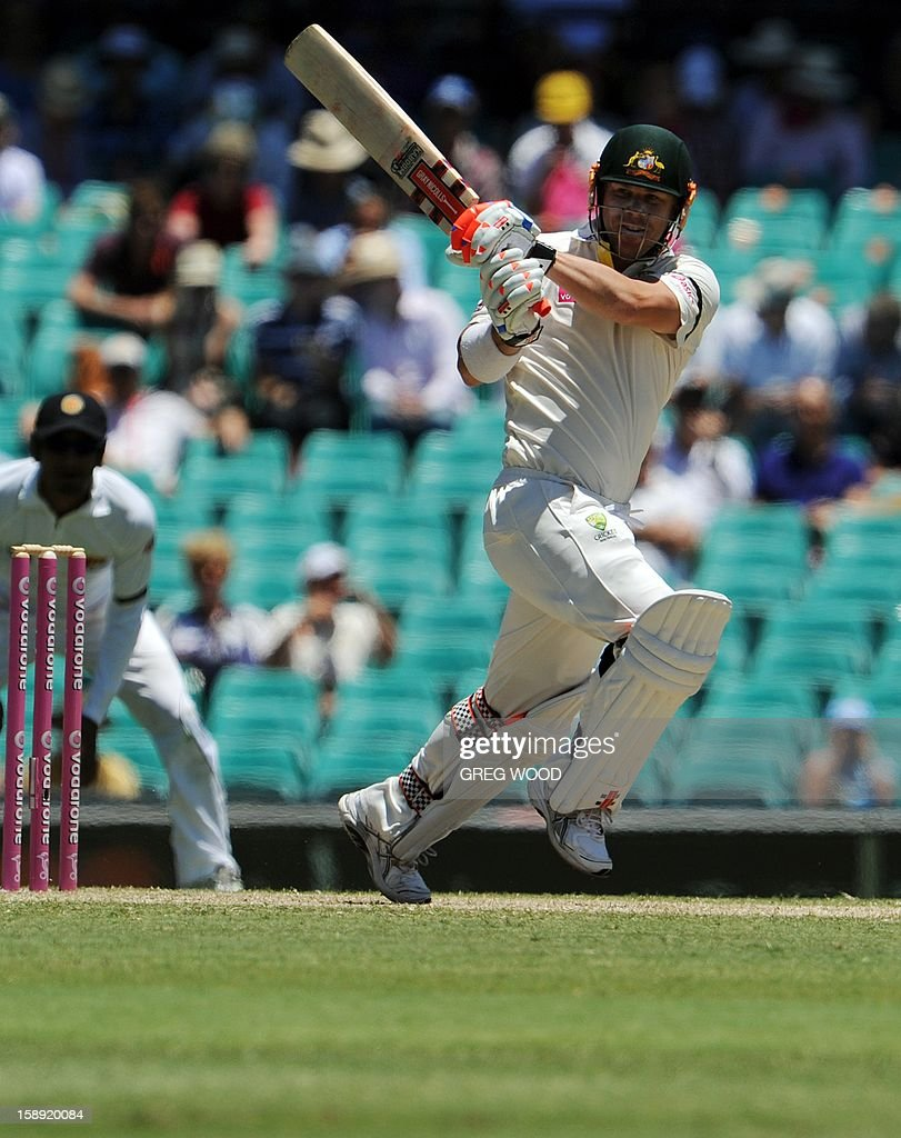 Australian batsman David Warner plays a pull shot on day two of the third cricket Test between Sri Lanka and Australia at the Sydney Cricket Ground on January 4, 2013. IMAGE STRICTLY RESTRICTED TO EDITORIAL USE - STRICTLY NO COMMERCIAL USE AFP PHOTO / Greg WOOD